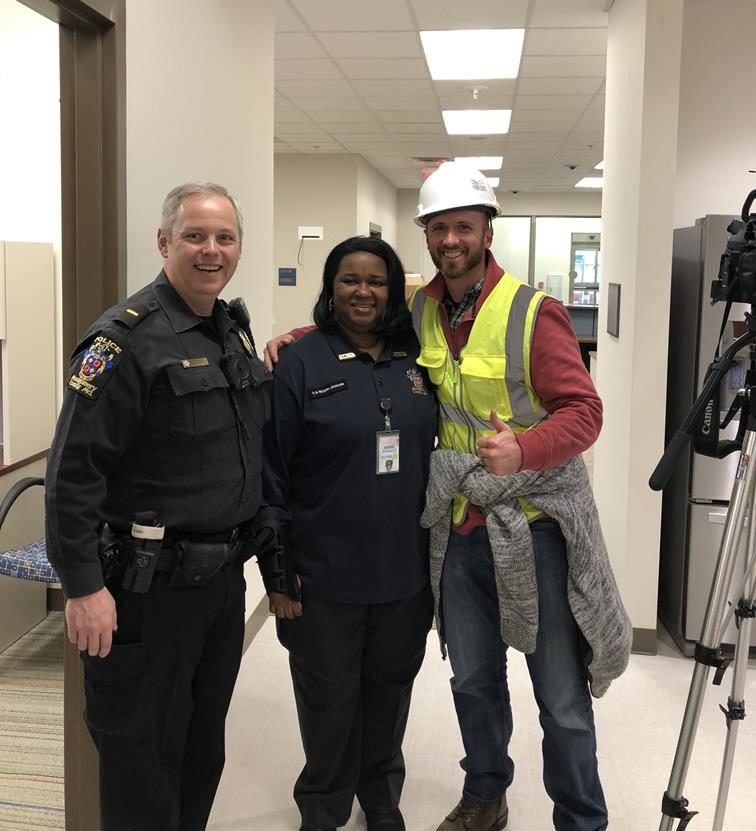 Spec Training Video's Tom Friedman standing with Bethesda Police Station staff.
